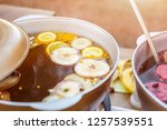 mulled wine prepared in iron... | Shutterstock . vector #1257539551