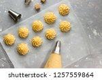 profiteroles  manufacturing... | Shutterstock . vector #1257559864