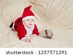 baby boy in santa costume... | Shutterstock . vector #1257571291