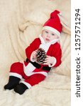 baby boy in santa costume... | Shutterstock . vector #1257571294