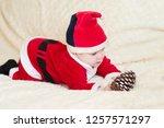 baby boy in santa costume... | Shutterstock . vector #1257571297