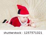 baby boy in santa costume... | Shutterstock . vector #1257571321