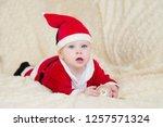 baby boy in santa costume... | Shutterstock . vector #1257571324