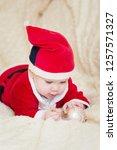 baby boy in santa costume... | Shutterstock . vector #1257571327