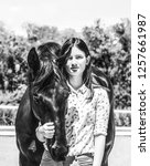 girl and horse  black and white ... | Shutterstock . vector #1257661987
