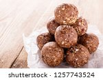 Small photo of nutty chocolate energy balls on parchment paper