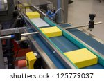 yellow boxes in production line | Shutterstock . vector #125779037