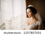bride posing in a lush white... | Shutterstock . vector #1257807031