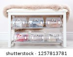 plastic boxes with female shoes ...   Shutterstock . vector #1257813781