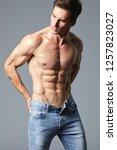 a handsome muscular  shredded...   Shutterstock . vector #1257823027