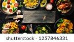 assortment of food. salad ... | Shutterstock . vector #1257846331