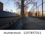 empty bench in a park on a... | Shutterstock . vector #1257857311