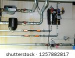 installing of a heating system... | Shutterstock . vector #1257882817