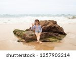 the concept of a beach holiday... | Shutterstock . vector #1257903214