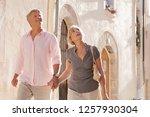 mature tourist couple walking... | Shutterstock . vector #1257930304