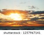 sun beams burst through the...   Shutterstock . vector #1257967141