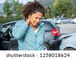woman feeling neck ache after... | Shutterstock . vector #1258018624