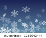 snow flakes falling macro... | Shutterstock .eps vector #1258042444