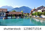 Beautiful landscape photo of River Aare and Swiss buildings in Interlaken, Unterseen, Switzerland