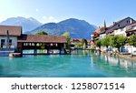 Beautiful landscape photo of River Aare and Swiss buildings in Interlaken, Unterseen, Switzerland