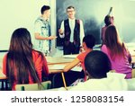 students listening the... | Shutterstock . vector #1258083154