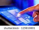 closeup of finger touching blue ... | Shutterstock . vector #125810801