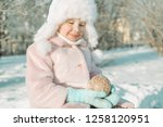 little girl with christmas toy... | Shutterstock . vector #1258120951