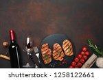 grilled pork steaks on stone... | Shutterstock . vector #1258122661