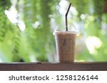 cup of iced mocha coffee with... | Shutterstock . vector #1258126144