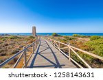 wooden footpath to ancient... | Shutterstock . vector #1258143631