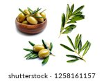 green olives and leaves on... | Shutterstock . vector #1258161157