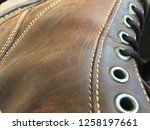 brown leather boot rivets laces ... | Shutterstock . vector #1258197661