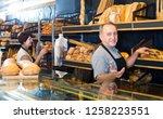 portrait of glad mature bakers...   Shutterstock . vector #1258223551