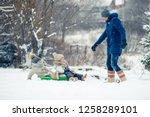 little girls enjoy a sleigh... | Shutterstock . vector #1258289101