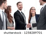 handshake to make a deal with... | Shutterstock . vector #1258289701