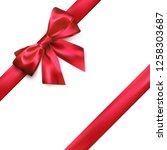 shiny red silk bow and ribbon...   Shutterstock .eps vector #1258303687