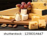 different types of cheeses....   Shutterstock . vector #1258314667