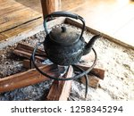 an old black kettle on the... | Shutterstock . vector #1258345294