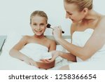 young mother with daughter are... | Shutterstock . vector #1258366654