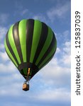 hot air balloon rising in the...