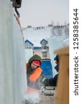 workers build an ice town from... | Shutterstock . vector #1258385644