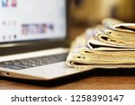 newspapers and laptop.... | Shutterstock . vector #1258390147