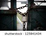 Rusty Chain And Padlock Around...