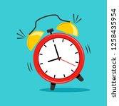 alarm clock on blue background. ... | Shutterstock .eps vector #1258435954