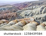 bizarre layered mountains in... | Shutterstock . vector #1258439584