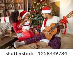 happy family sitting on floor... | Shutterstock . vector #1258449784