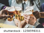 people drinking alcohol and... | Shutterstock . vector #1258598311