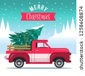 pickup truck with christmas tree | Shutterstock .eps vector #1258608874