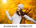 happy girl in a yellow autumn... | Shutterstock . vector #125861225