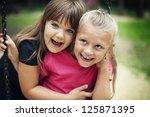 Happy Little Girls Swinging In...